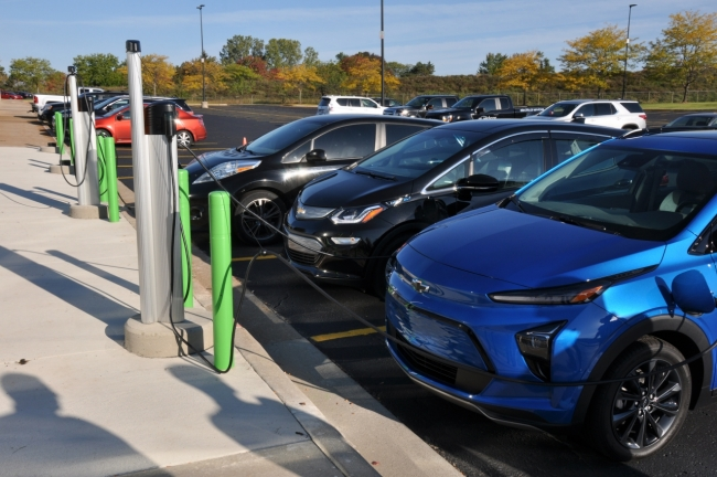 cars parked by EV charging stations