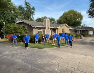 GP team posing in front of house